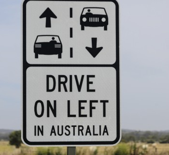 Drive on left in Australia warning road sign